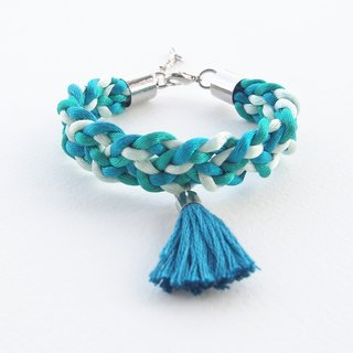 Green and blue braided bracelet with green tassel