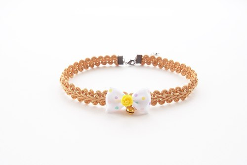 Pumpkin yellow choker / necklace with bow and bell.
