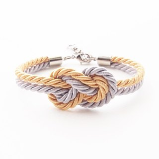 Gold and gray infinity knot rope bracelet.
