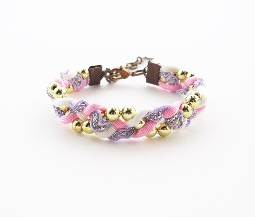 Pink and lilac woven bracelet with beads.