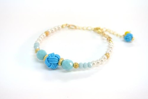 Turquoise color of mizuhiki and pearl bracelet