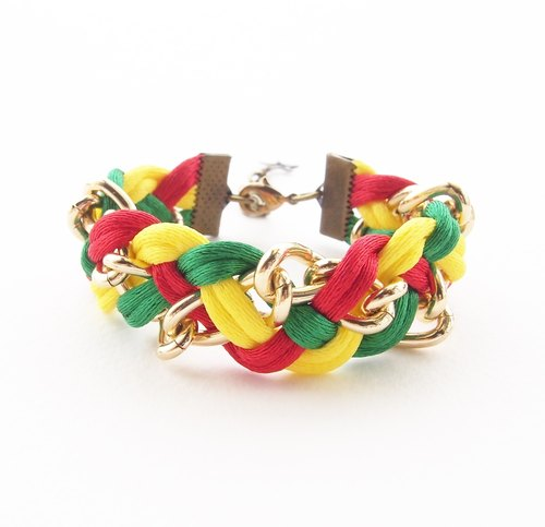 Red, yellow and green braided bracelet with gold chain.
