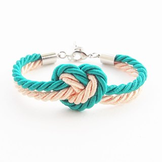Green mint and peach heart knot bracelet.
