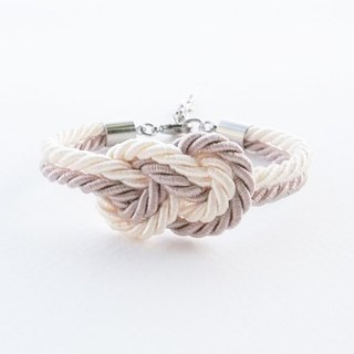 Ivory cream / light gray infintity knot rope bracelet.