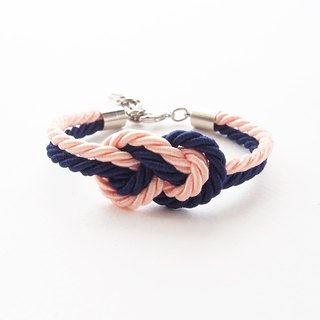Navy blue and peach infinity knot rope bracelet.