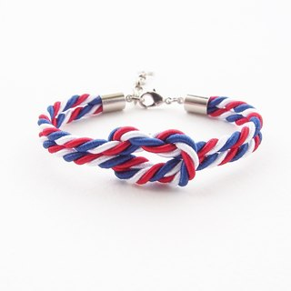 Blue / white / red knot rope bracelet.
