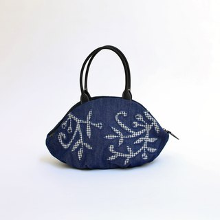 Embroidered wooden crane · almond bag