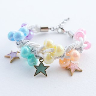 White bracelet with colorful pastel beads and pastel star charms