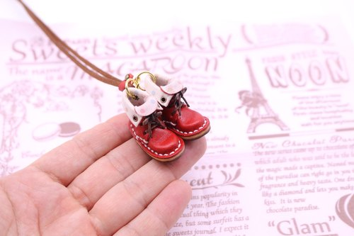 Of small leather boots necklace | with strawberry lining