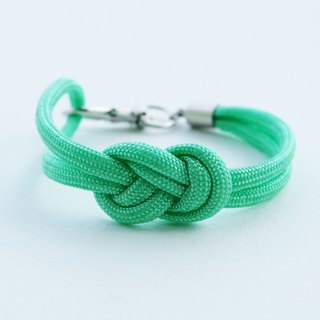 Paracord infinity-knot with metal clip bracelet in MINT