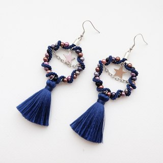 Navy blue circular earrings with tassel and star