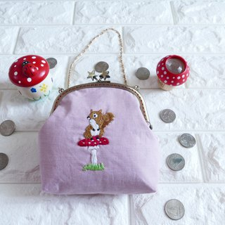 Sitting on a mushroom sitting on a handbag with embroidery squirrel pink