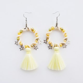 Light yellow circular earrings with tassel and star