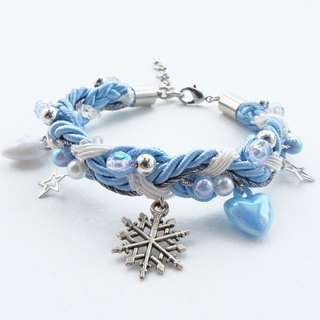 Snowflake charm braided bracelet in blue gray