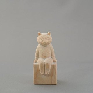 Wood carving cat.A sitting cat.