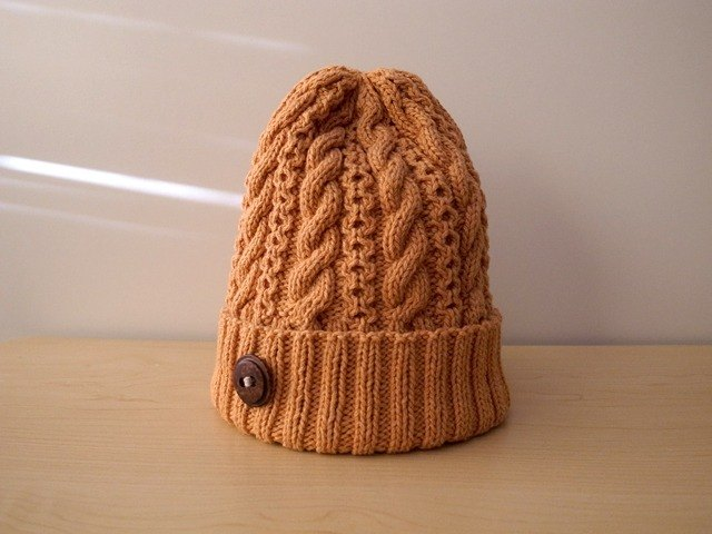 Knit hat Knit hat of orange cotton wool