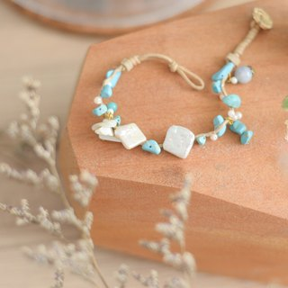 a handmade lucky soft blue lucky stone bracelet comes with the real pearl by niyome craft