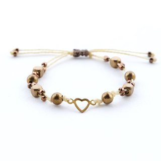Brass heart and beads yellow string bracelet