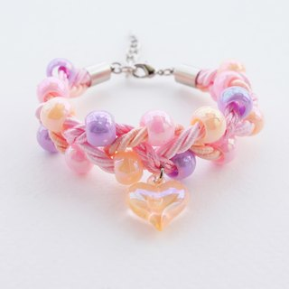 Peach-pink braided bead bracelet and heart charm