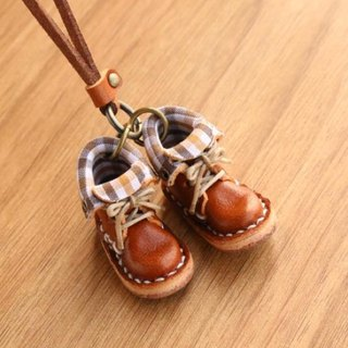 Of small leather boots necklace | with chocolate lining