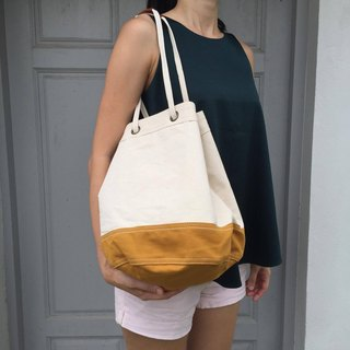 Off-white/mustard Canvas 2way Bucket Bag w/ Strap Leather Handles.