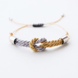 Tiny tie the knot rope bracelet in Light gray / Gold