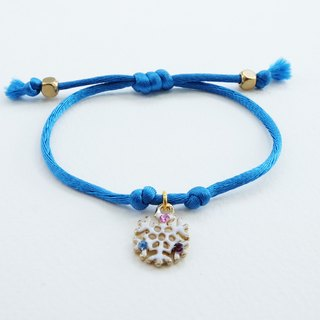 Blue silk rope bracelet with snowflake charm