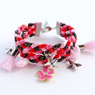 Pink double-layered bracelet with flower , star and heart charms