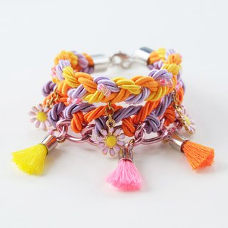 Colorful pink yellow orange purple braided bracelet with flowers and tassels