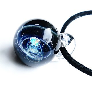 The crystal of a clear sparkling diamond. Diamond cut glass pendant star planetary universe
