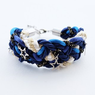 Navy blue braided bracelet with silver stars