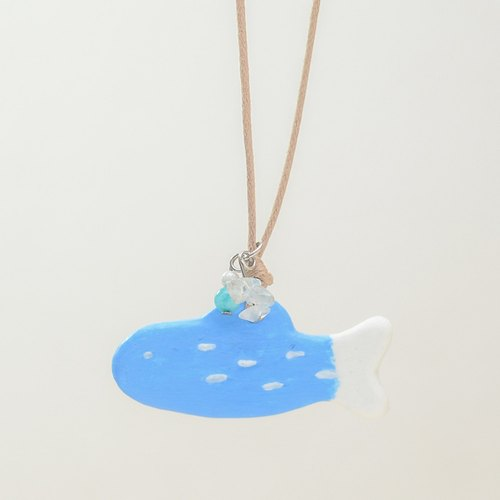 a little blue fish handmade necklace from Niyome clay.