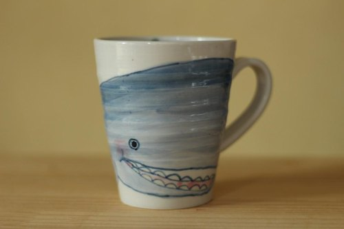 A big cup of whale and ship.