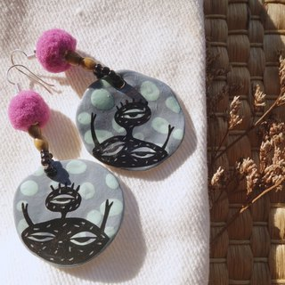 Ceramic earring inspired by monster.