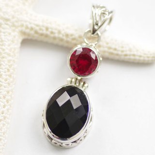 Silver pendant of onyx and ruby