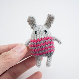 Sockinette the Bunny - knitted amigurumi brooch