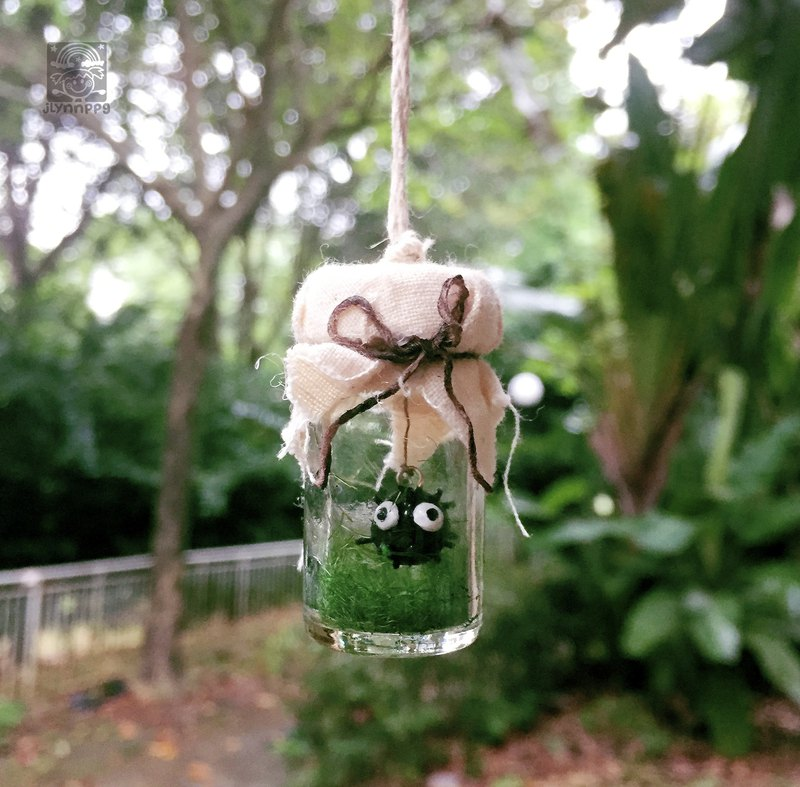handmade Makkurokurosuke (Dust bunnies) in a bottle