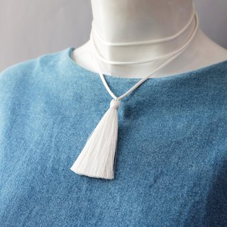 White layered choker with tassel