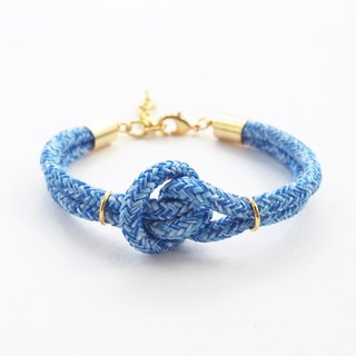 Blue knot bracelet with gold material