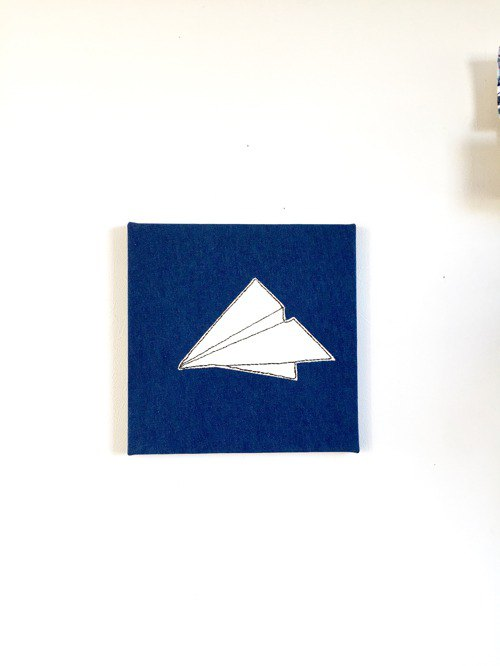 Fabric panel paper airplane