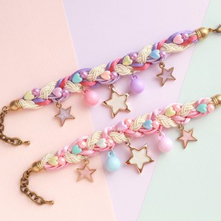 Purple pink braided bracelet with white glittering and lilac stars