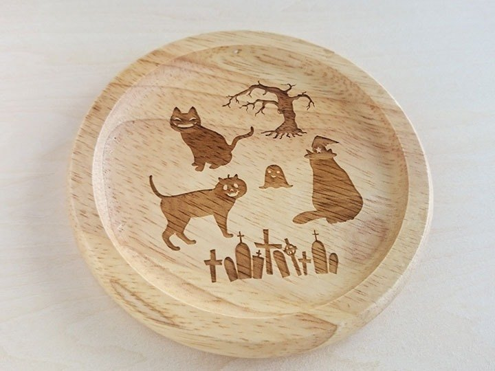 Halloween costume coaster in the cat and her grave